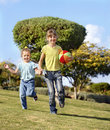 Children running in park. Stock Photography
