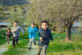 Children running a race in the wilderness against each other Royalty Free Stock Images