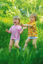 Children runs in the grass Royalty Free Stock Photos
