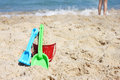 Children s beach toys bucket spade and shovel on sand on a sunny day Stock Photo