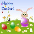 Children's card for Easter with painted eggs and rabbit on floral meadow Royalty Free Stock Photo