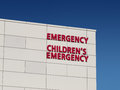 Children s emergency hospital on building against blue sky Royalty Free Stock Image