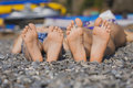 Children s feet on grass family picnic the beach Stock Photos