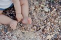 Children s feet in the sand summer on beach little baby bare Stock Photo