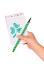 Children's hands hold notebook with painted clover Royalty Free Stock Image