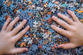 Children`s hands on Jigsaw puzzle color background Royalty Free Stock Photo