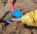 Children's hands playing with sand in a sandbox Royalty Free Stock Photo