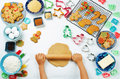 Children`s hands roll ginger dough with Gingerbread cookies and