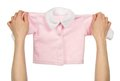 Children s jacket with buttons in the female hands isolated on white Royalty Free Stock Photo