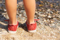 Children's legs in the sand Royalty Free Stock Photography