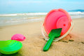 Children`s pail and colored molds on the beach in the sand Royalty Free Stock Photo