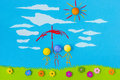 Children s play protection figurative family protected from rain under red umbrella in a cloudy day with green grass and blue sky Royalty Free Stock Images