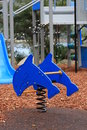 Children s playground equipment in a public park Royalty Free Stock Photos