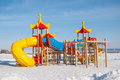 Children s playground with slides and ladders on the city waterfront winter Royalty Free Stock Photography