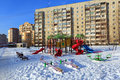 Children s playground in winter balashikha moscow region a on the background of a multi storey panel residential building russia Royalty Free Stock Image