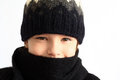 Children s portrait little girl in knitted hat and scarf on a white background Stock Image
