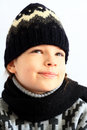 Children s portrait little girl in knitted hat and scarf on a white background Royalty Free Stock Image