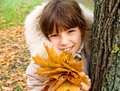 Children s portrait of a young girl on the background of autumn leaves Stock Photos