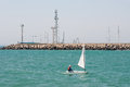 Children's sailing yacht and lighthouse in Pomorie. Bulgaria Royalty Free Stock Photo