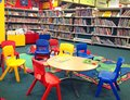 Children s seating in a public library and tables books the background this is bedford the united kingdom Stock Image