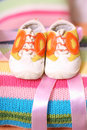 Children s shoes on a beautiful cushion Royalty Free Stock Image