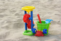 Children's toy: bucket, mill, form on sand Royalty Free Stock Photo