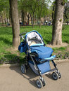 Children's walking carriage. Stock Image