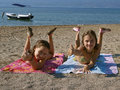 Children on sandy beach Royalty Free Stock Photo