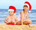 Children in santa hat on  beach. Stock Photos