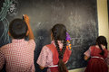 Children in school s writing black board Royalty Free Stock Photography