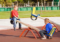 Children on a seesaw Royalty Free Stock Image