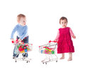 Children and shopping boy girl play with trolley toys isolated on white Royalty Free Stock Photo