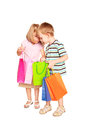 Children shopping young couple little boy and little girl checking looking bags isolated on white background Stock Photos