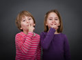 Children silence please expression and emotion in gray background Stock Photography