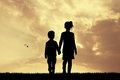 Children silhouette at sunset Royalty Free Stock Photo