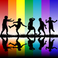 Children silhouettes playing over rainbow backgrou black background Stock Image