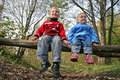 Children sit in park Stock Photo