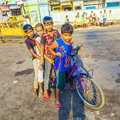 Children sitting on a bike early delhi india oct morning october in delhi india cycling accounts for to of the commuter trips Royalty Free Stock Photos