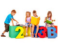 Children sitting at cube hand up Royalty Free Stock Image