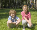 Children sitting on grass Stock Image