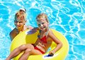 Children sitting inflatable ring swimming pool Royalty Free Stock Photography