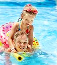 Children sitting inflatable ring swimming pool Stock Image