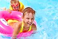 Children sitting inflatable ring swimming pool Stock Photography
