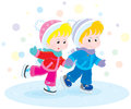 Children skating little boy and girl skates on a ice rink Royalty Free Stock Photo