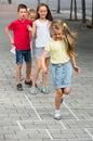 Children skipping hopscotch Royalty Free Stock Photo