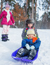 Children on sleds in snow Stock Image