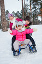 Children on sleds in snow cute three kids forest focus the boy Royalty Free Stock Image