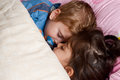 Children are sleeping peacefully on the bed little brother and sister resting together Stock Image