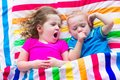 Children sleeping under colorful blanket Royalty Free Stock Photo