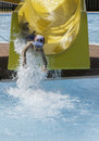 Children slide down a water slide sunny day Stock Photography